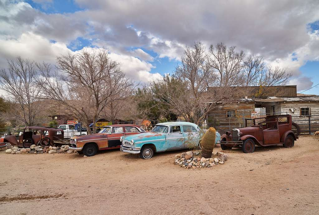 Cars well past their prime give old-time ambience to the scene outside the Hackberry General Store in the dot of a place called Hackberry along old U.S. 66 in northwestern Arizona