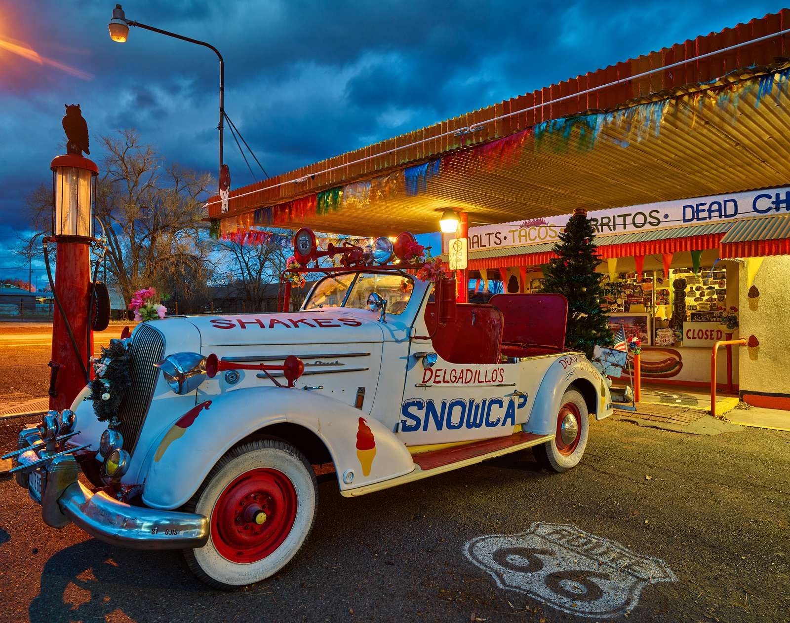 Scene outside Delgadillo's Snow Cap Drive-In restaurant, a historic eatery and roadside attraction in Seligman, Arizona, along old U.S. highway 66