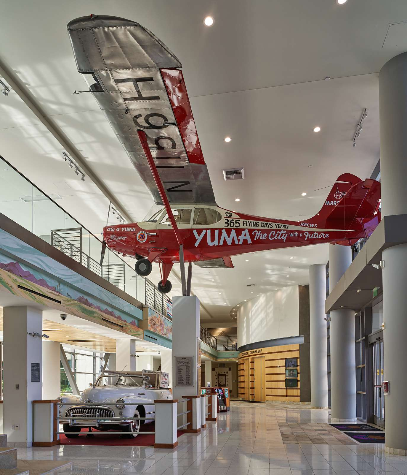 This single-engine plane and the adjacent 1948 Buick automobile, displayed in Yuma, Arizona's, city hall, have a history together