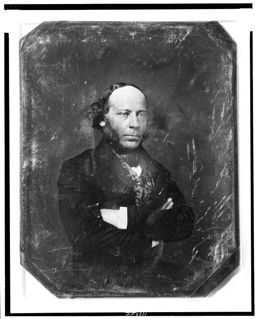 [Edward John Phelps, half-length portrait, three-quarters to the right, arms folded]