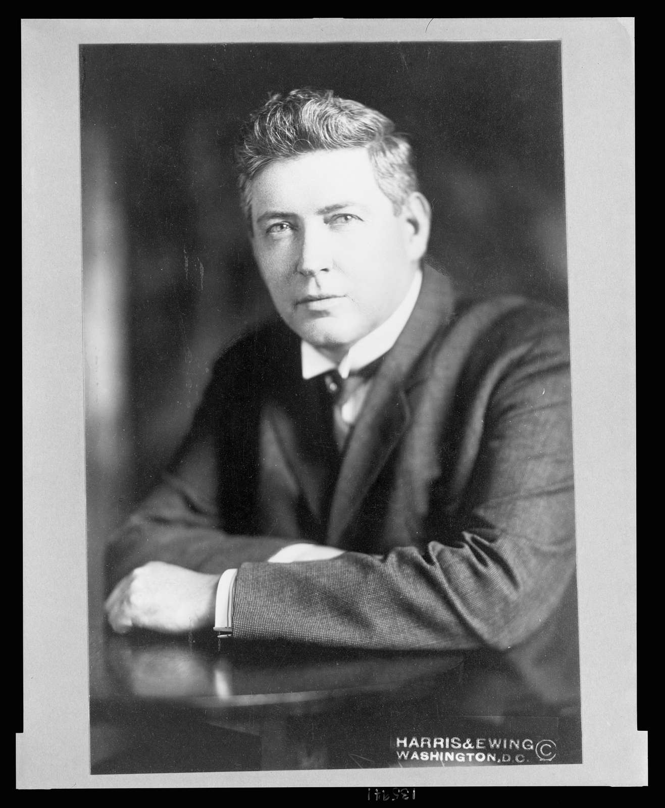 [Rep. Nicholas John Sinnott, Republican from Oregon, half-length studio portrait, seated, facing slightly left]