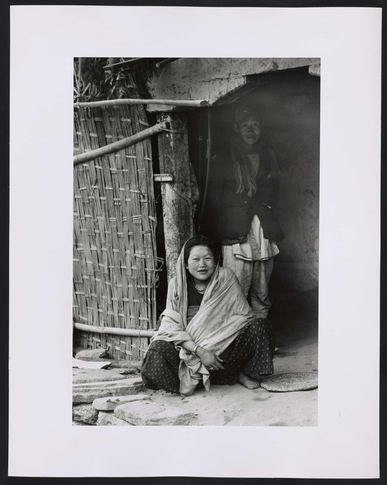 [Portrait of a woman and man, possibly Nepalese, Sikkim]