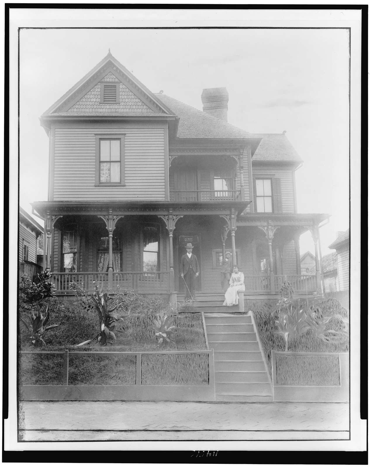 [Three African Americans on porch, in Georgia]
