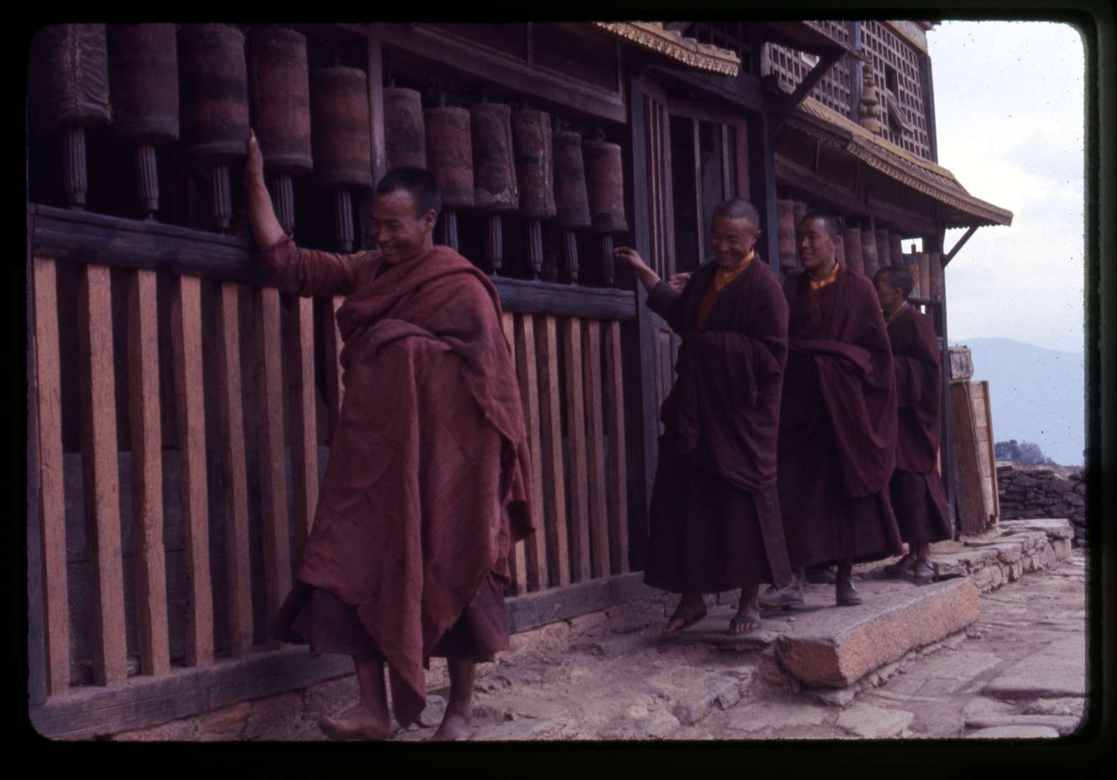 [Lamas spinning prayer wheels at old Rumtek Monastery, Sikkim]