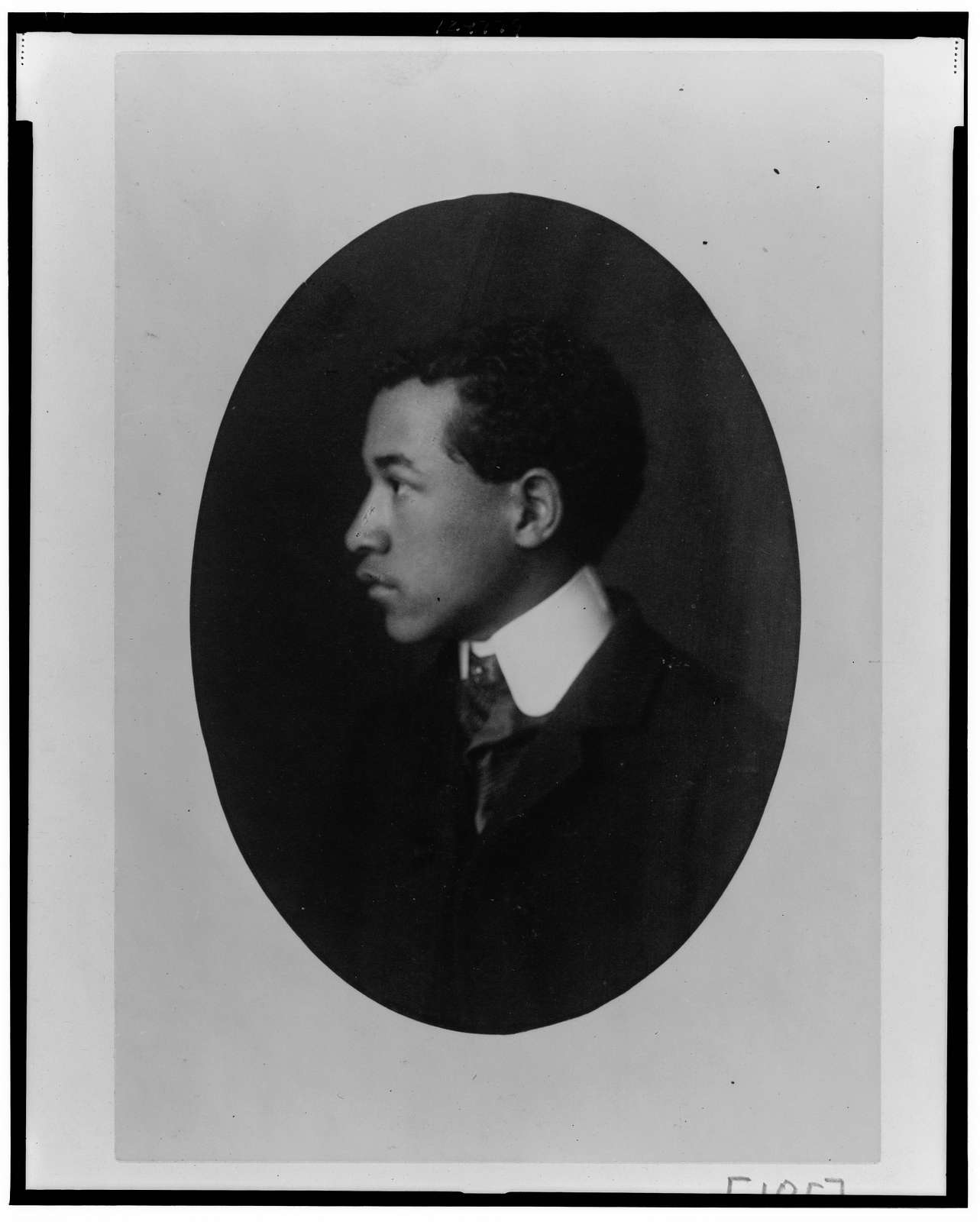 [African American man, head-and-shoulders portrait, left profile]