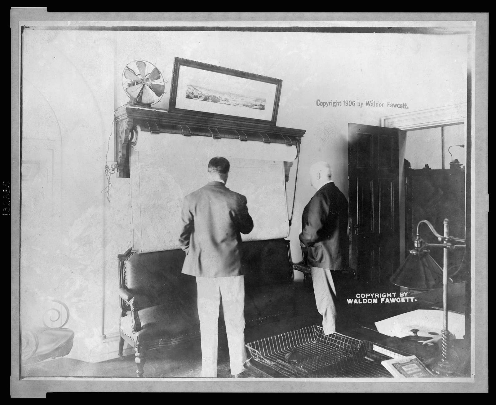 U.S. Secret Service Chief John E. Wilkie examining map in his office