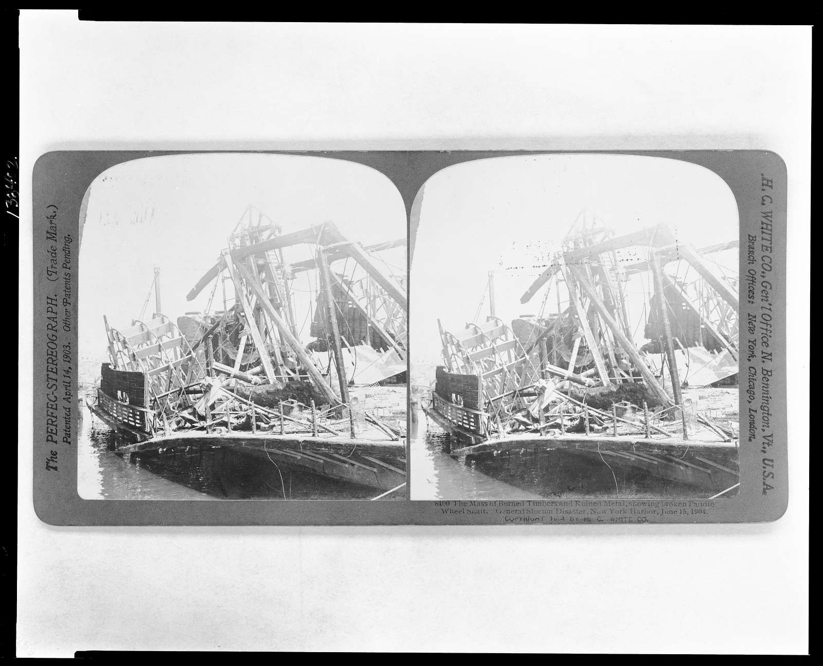 The mass of burned timbers and ruined metal, showing broken paddle wheels s[h]a[f]t. General Slocum Disaster, New York Harbor, June 15, 1904
