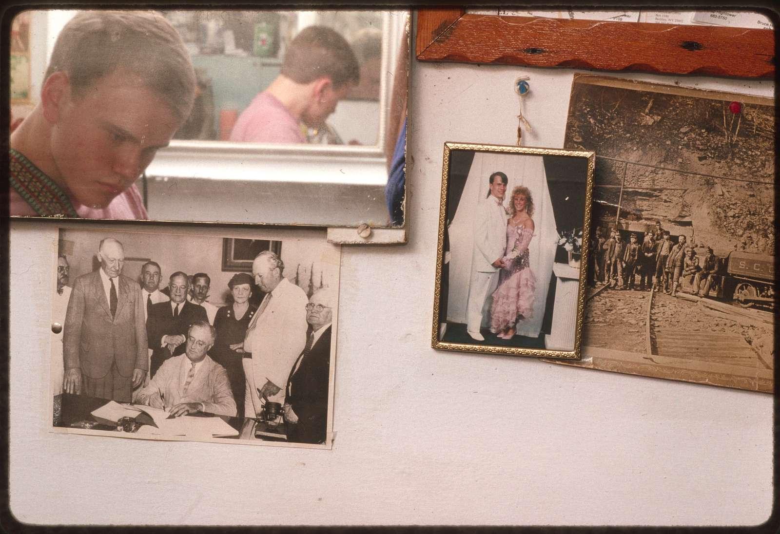 Community memorabilia on the wall of Frazier Gills' barbershop in Coal City