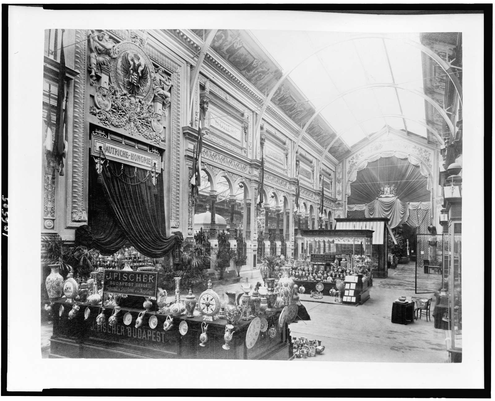 [Interior of the Palace of Diverse Industries, showing an exhibit of porcelain and majolica by J. Fischer, Budapest, Hungary, Paris Exposition, 1889]