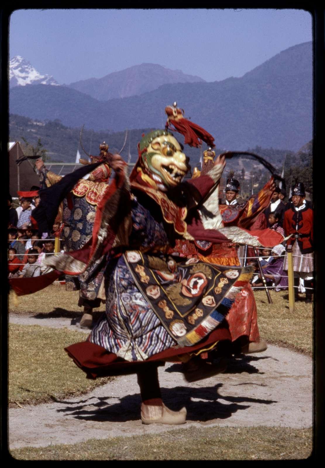Ceremonial masked lama dancer