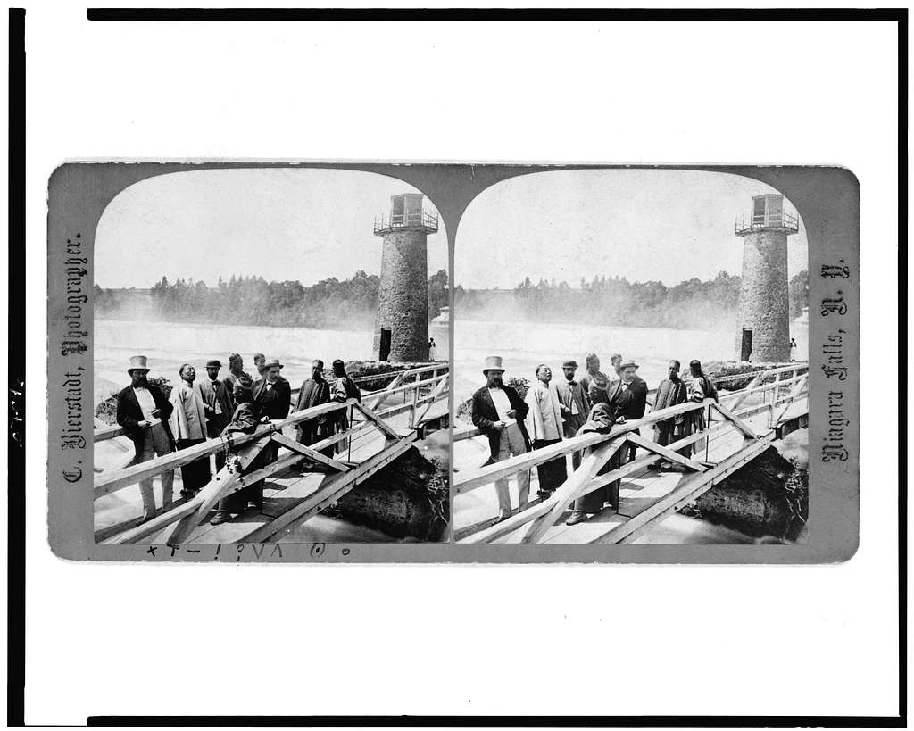 [Chinese and others on small bridge, with tower in background, Niagara Falls, N.Y.]