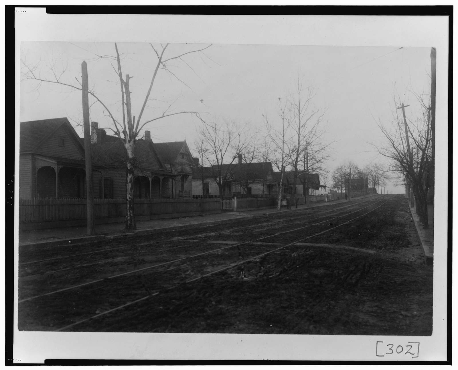 [View of unpaved street with houses in Georgia]