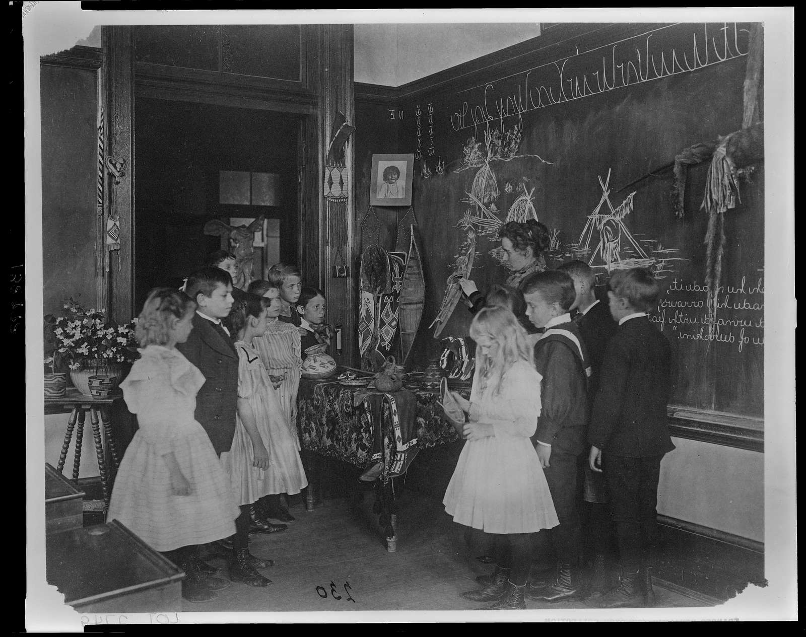 [Teacher showing students Native American handicrafts at a school in Washington, D.C.]
