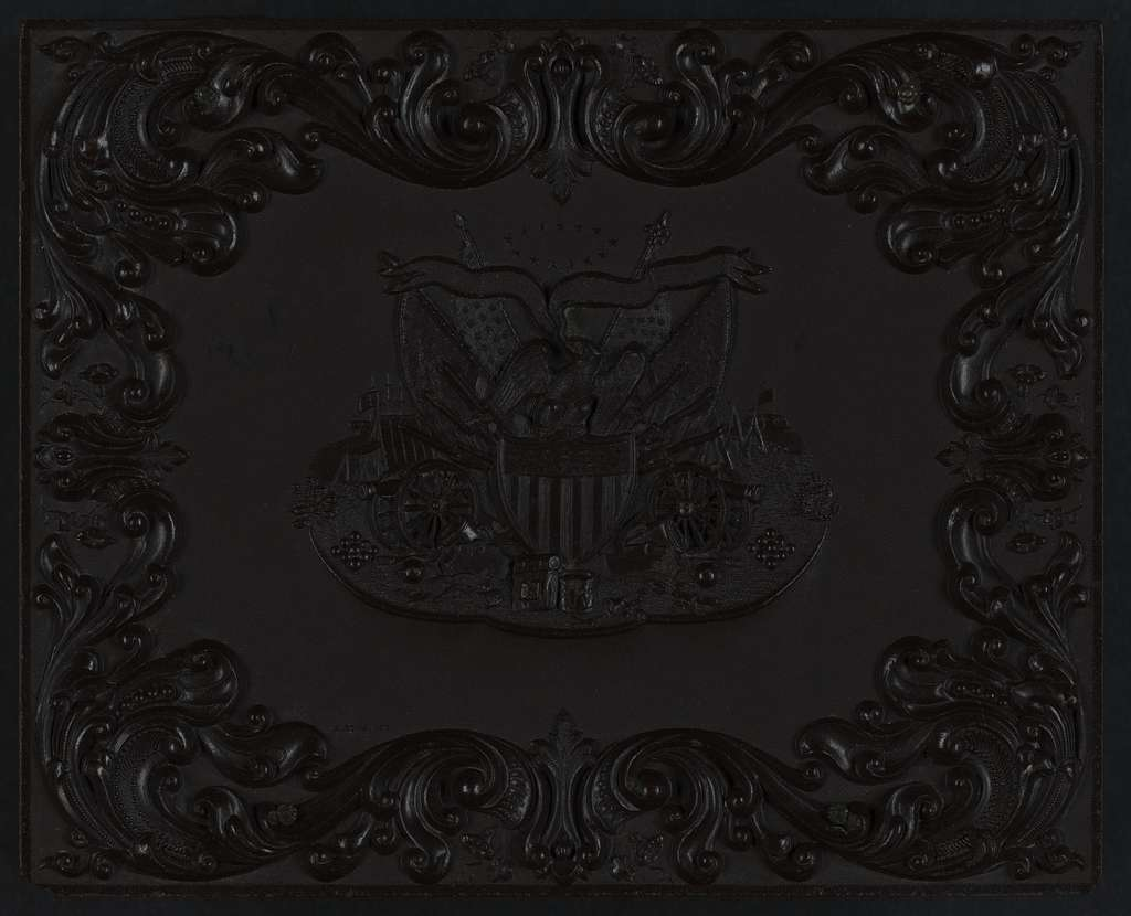 [Union case manufactured by Littlefield, Parsons & Co. showing eagle with Union shield and military weaponary with scroll embellishments]