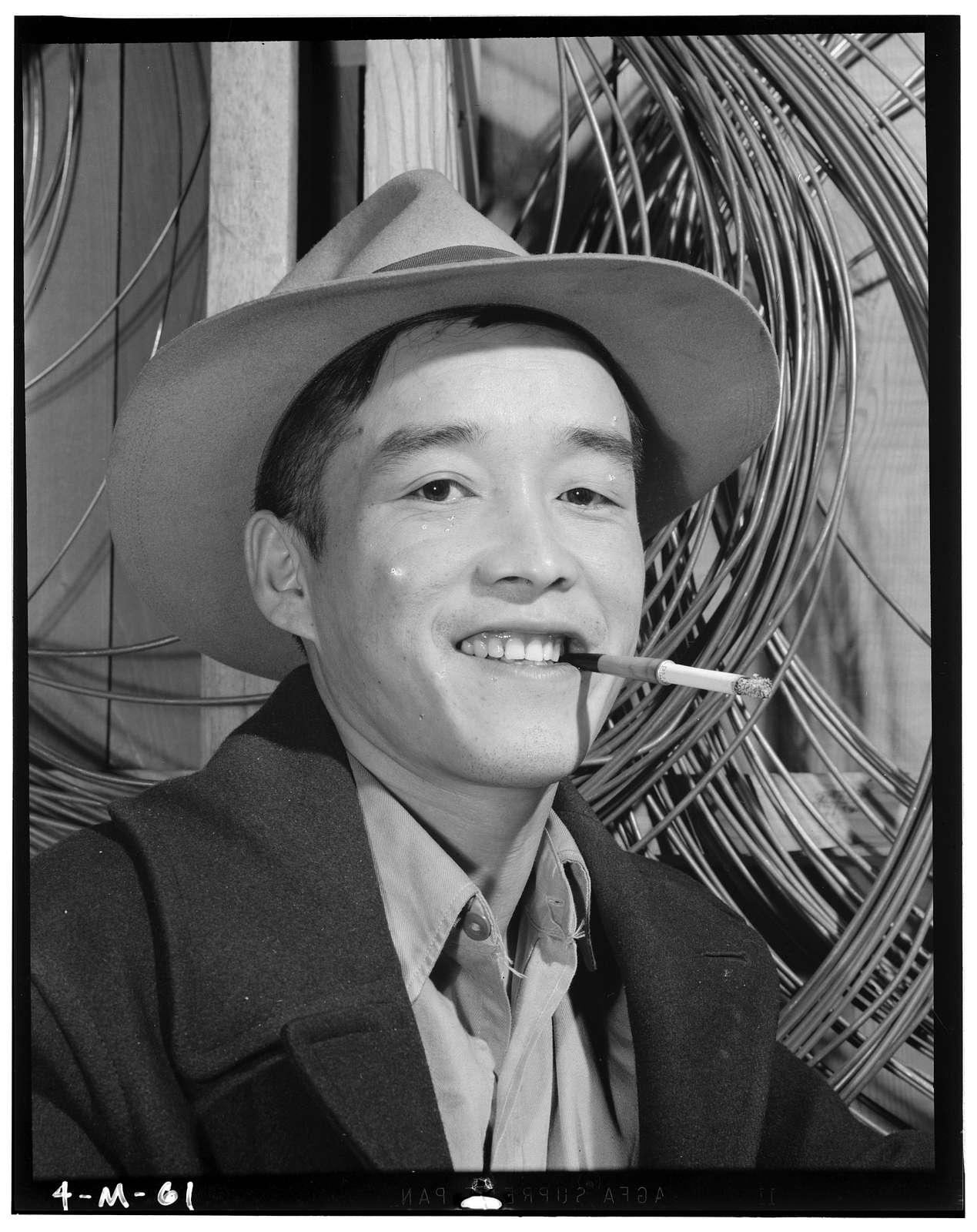 Yonehisa Yamagami, electrician, Manzanar Relocation Center, California / photograph by Ansel Adams.
