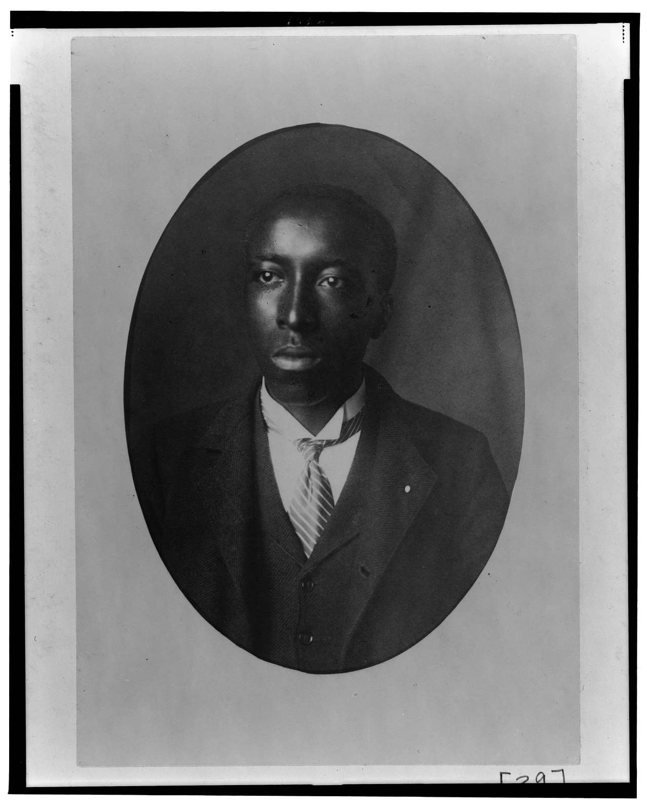 [African American man, head-and-shoulders portrait, facing slightly left]