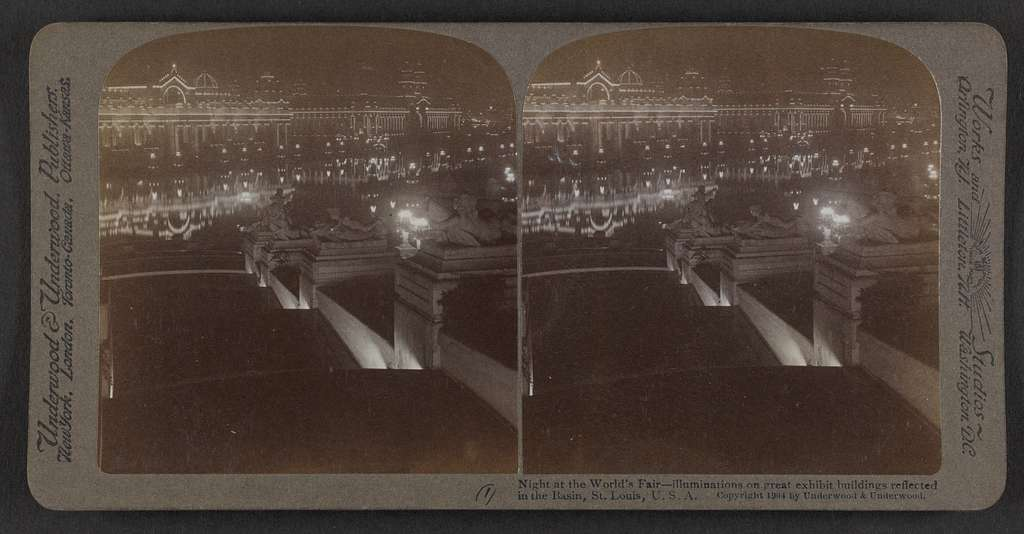 Night at the World's Fair, illuminations on great exhibit buildings reflected in the Basin, St. Louis,  U.S.A.
