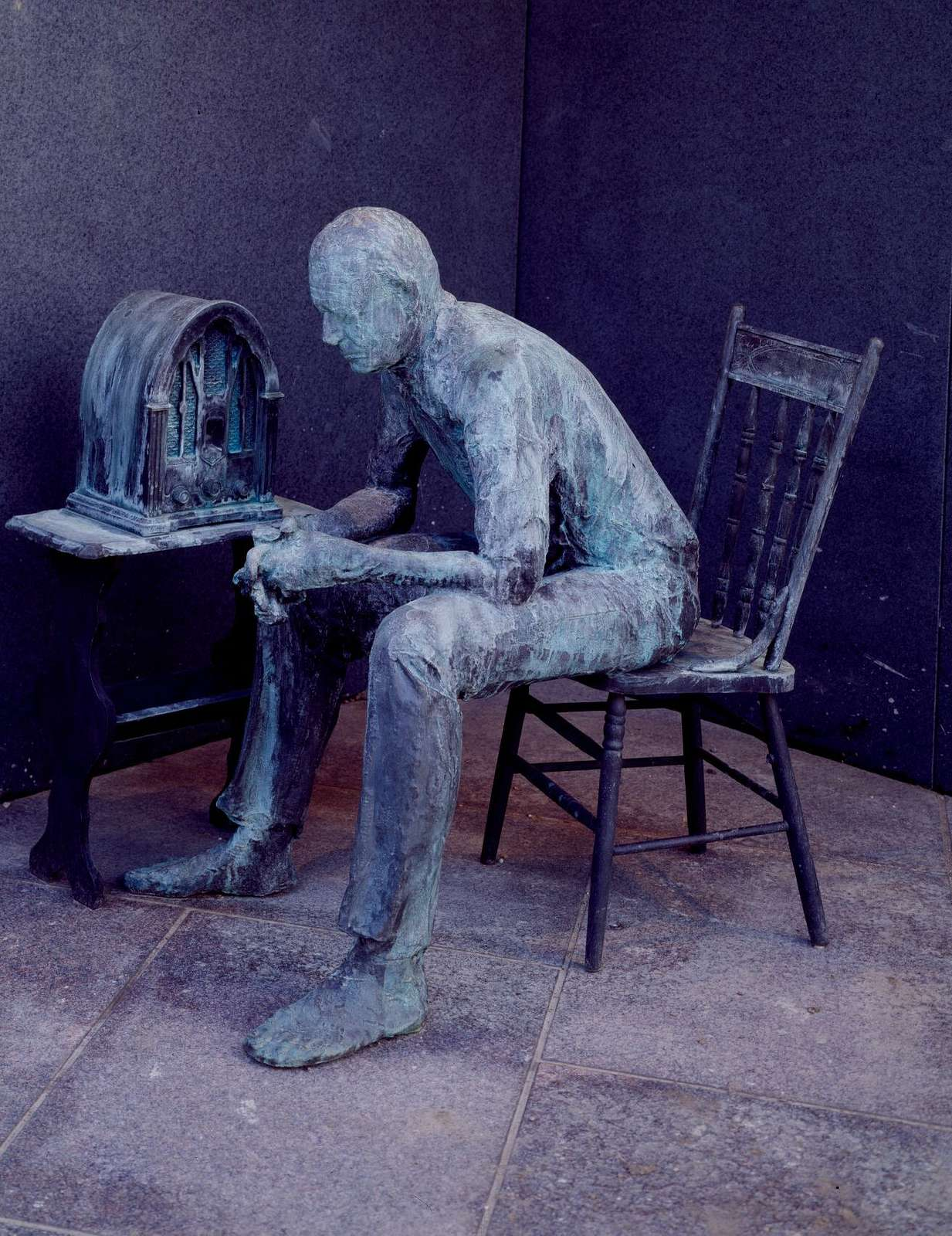 """Statue by George Segal of a citizen listening to one of President Roosevelt's """"fireside chats"""" at the Franklin Delano Roosevelt Memorial, Washington, D.C."""