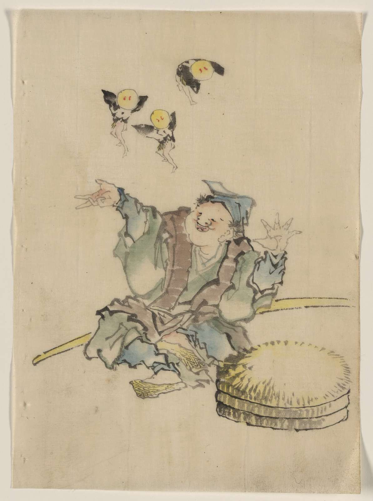 [A man, sitting on the ground, is wearing several layers of clothing, a peaked cap, and sandals; three large disks topped with straw are on the ground in front, a long staff behind, and three fairies dance in the air overhead]