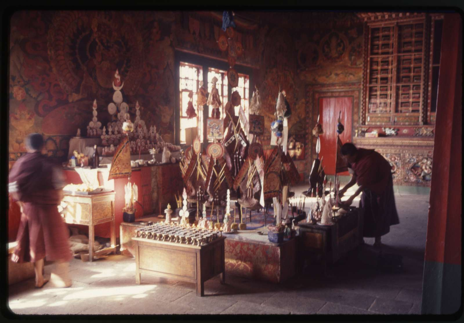 [Altar with butter lamps, butter paste offerings (torma) and images to be burned at the end of New Year's ceremony in the palace monastery, Gangtok, Sikkim]