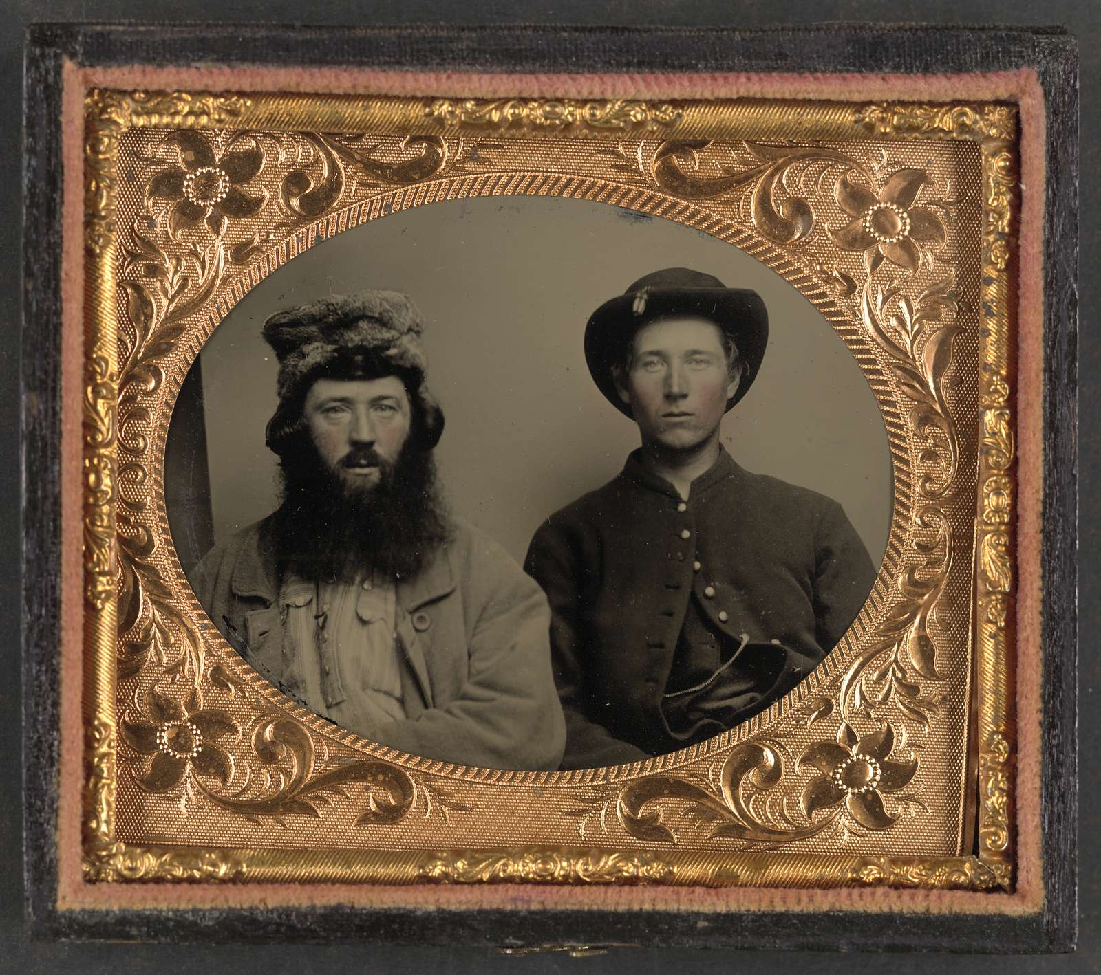 [Unidentified soldier in Union uniform and unidentified man with full beard in fur hat]