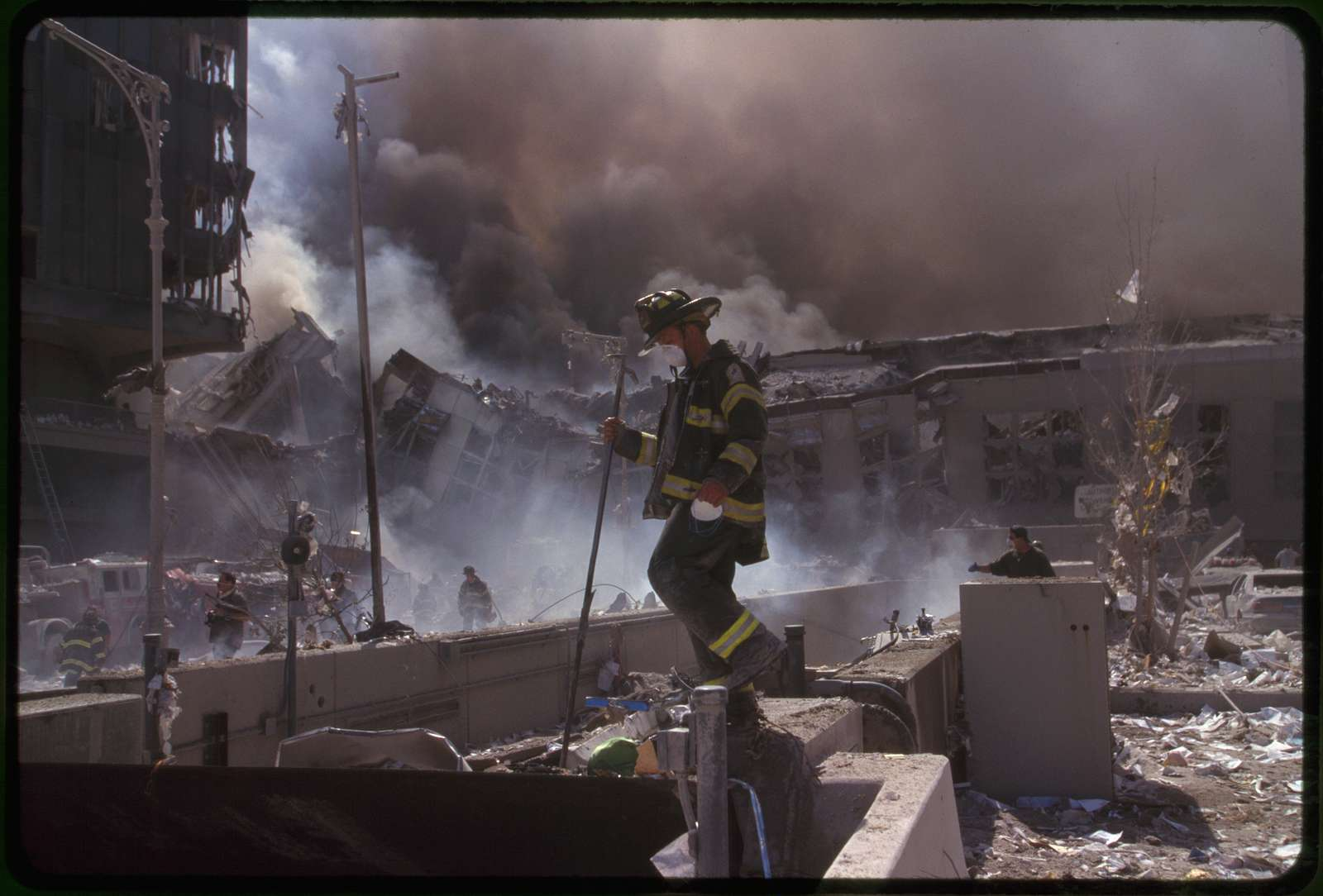 [Fire fighters amid smoking rubble following September 11th terrorist attack on World Trade Center, New York City]