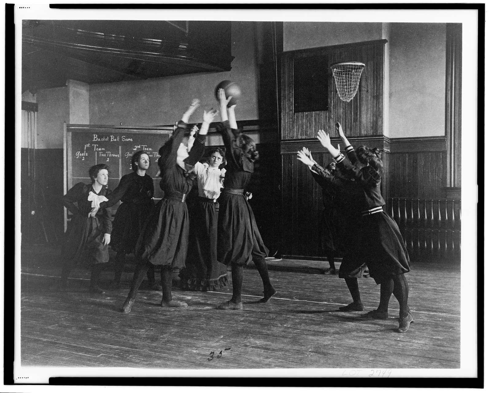 [Female students playing basketball in a gymnasium, Western High School, Washington, D.C.]