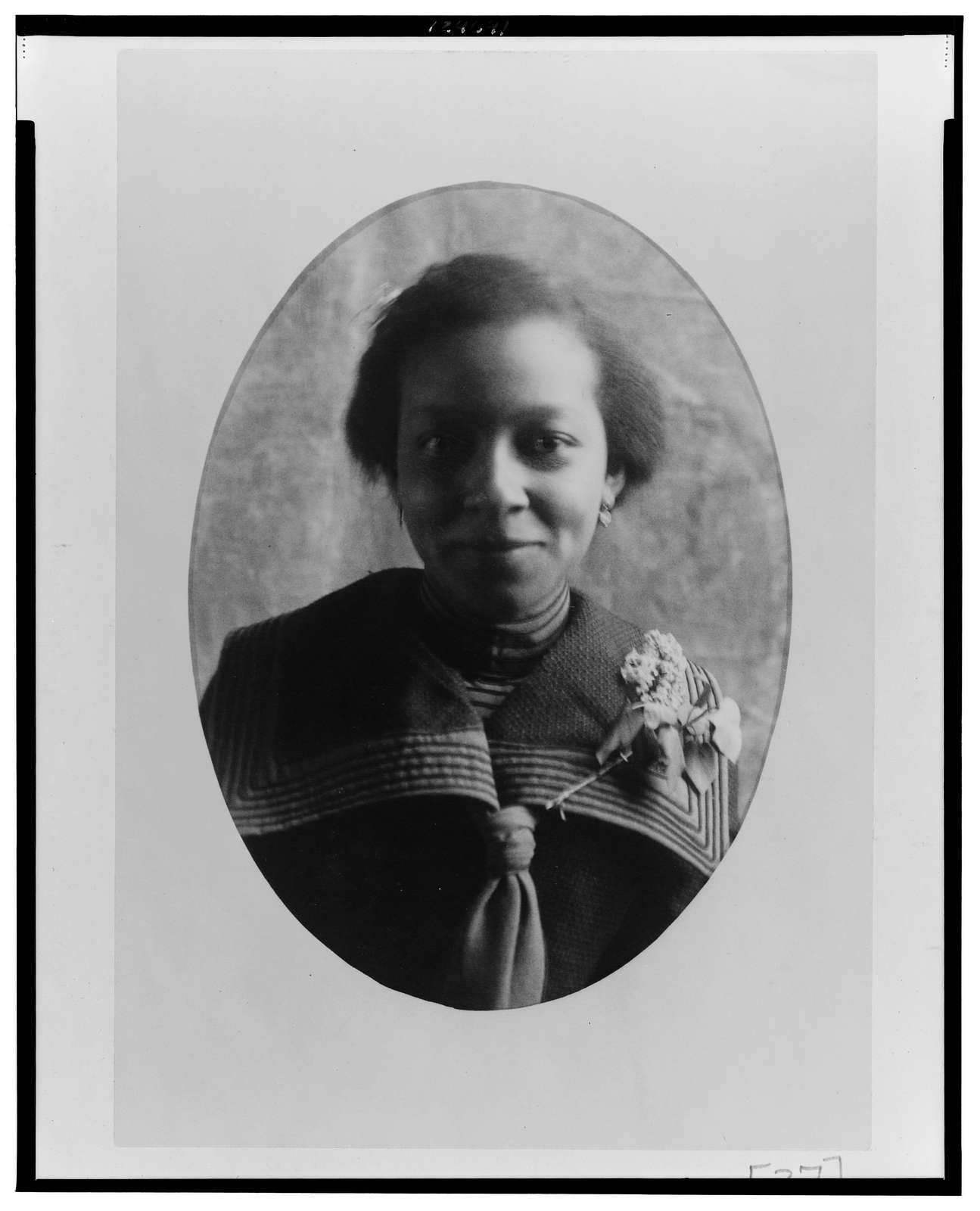 [African American woman, head-and-shoulders portrait, facing front]
