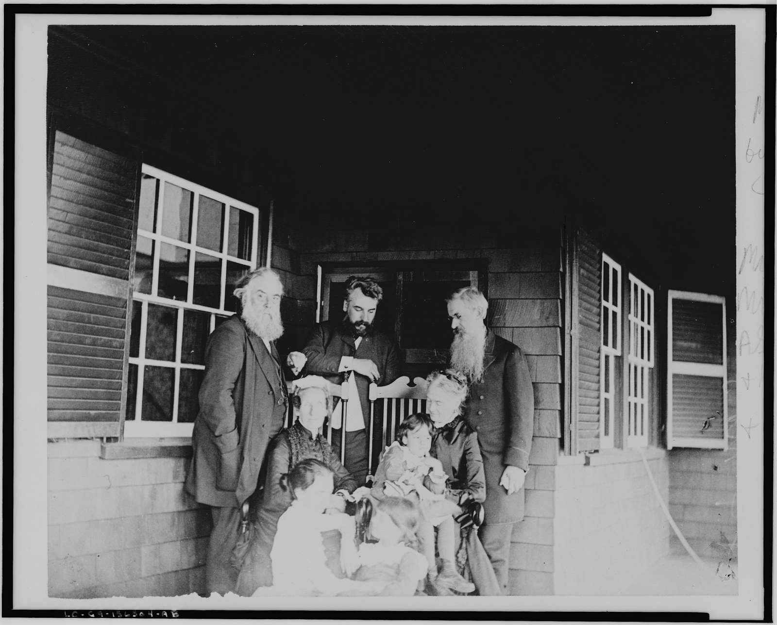 [Alexander Graham Bell, his wife and daughters, with Mr. and Mrs. Alexander Melville Bell and Mr. and Mrs. Gardiner Greene Hubbard on porch at Manchester-by-the-Sea]