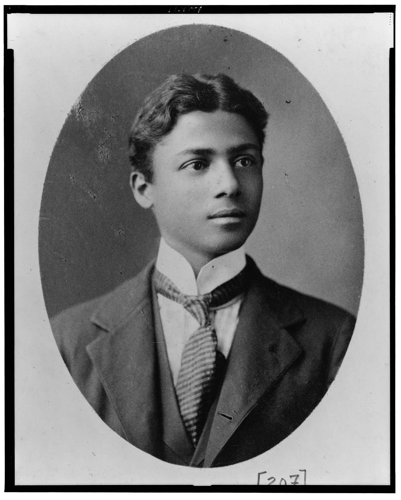 [African American man, head-and-shoulders portrait, facing right]