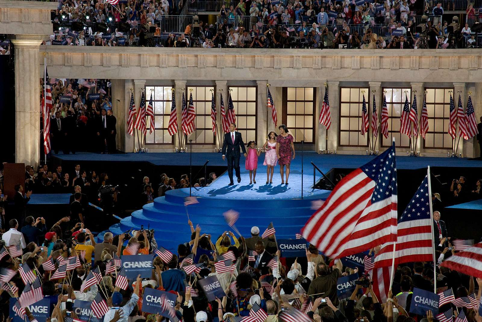 Presidential candidate Barack Obama, his wife Michelle, and his children Malia and Sasha wave to the audience at the Democratic National Convention, Denver, Colorado, August 25-28, 2008