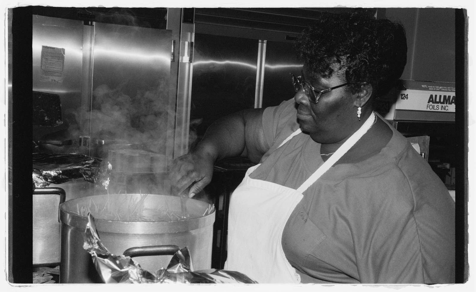 The cook at Memorial Day Care preparing lunch for the students.