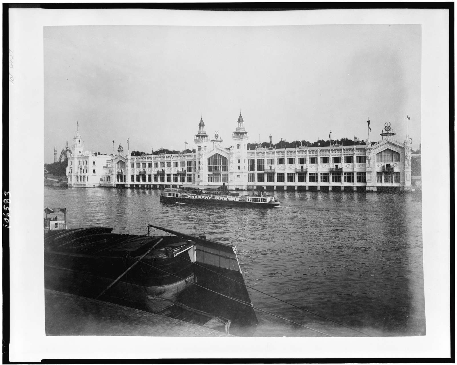 [Food Products Pavilion, with Pavilion of Portugal at far left, seen from across the River Seine, Paris Exposition, 1889]