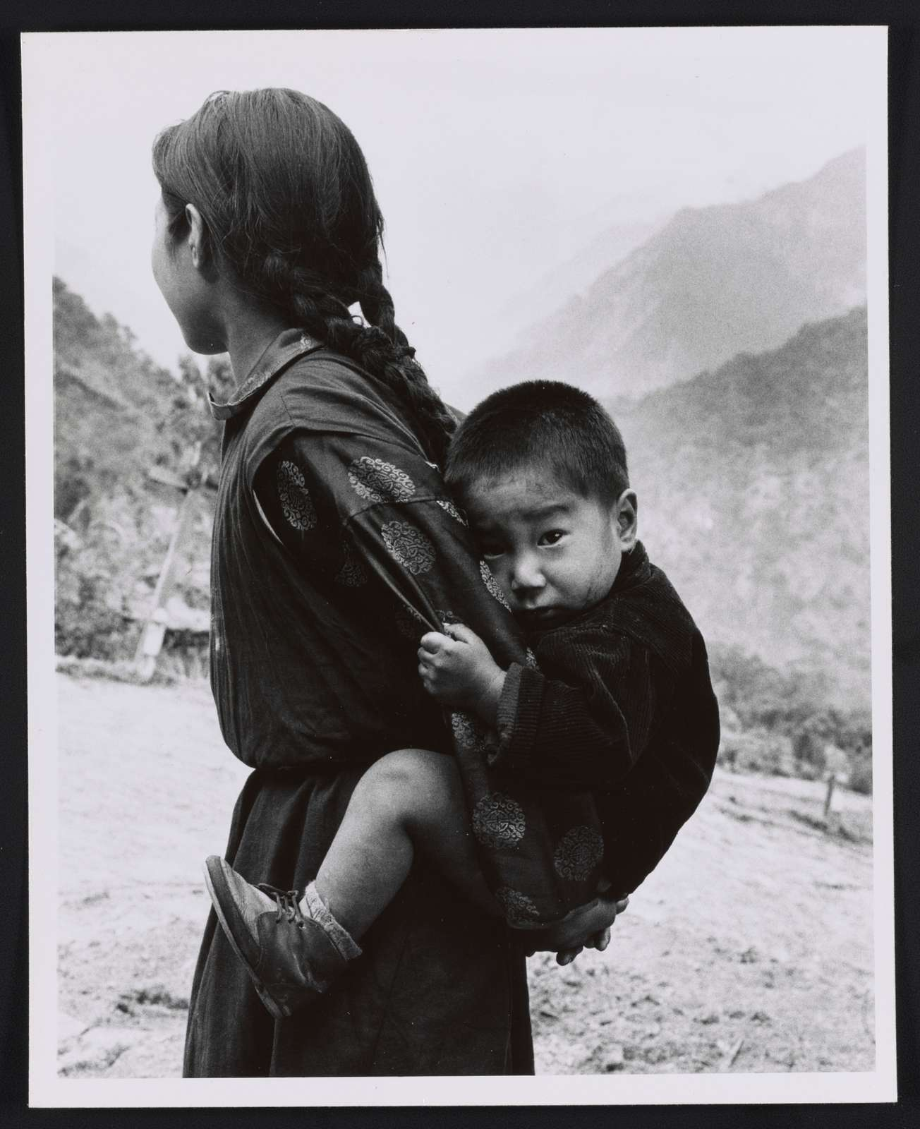 [Young woman with a small child on her back, Sikkim]