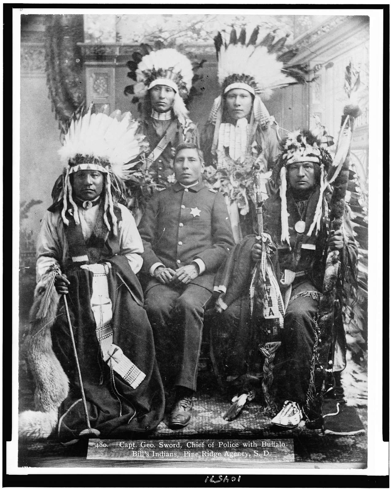 Capt. Geo Sword, chief of police with Buffalo Bill's Indians, Pine Ridge Agency, S.D. / W.R. Cross, portrait & view photographer, ... Hot Springs, S. Dak.