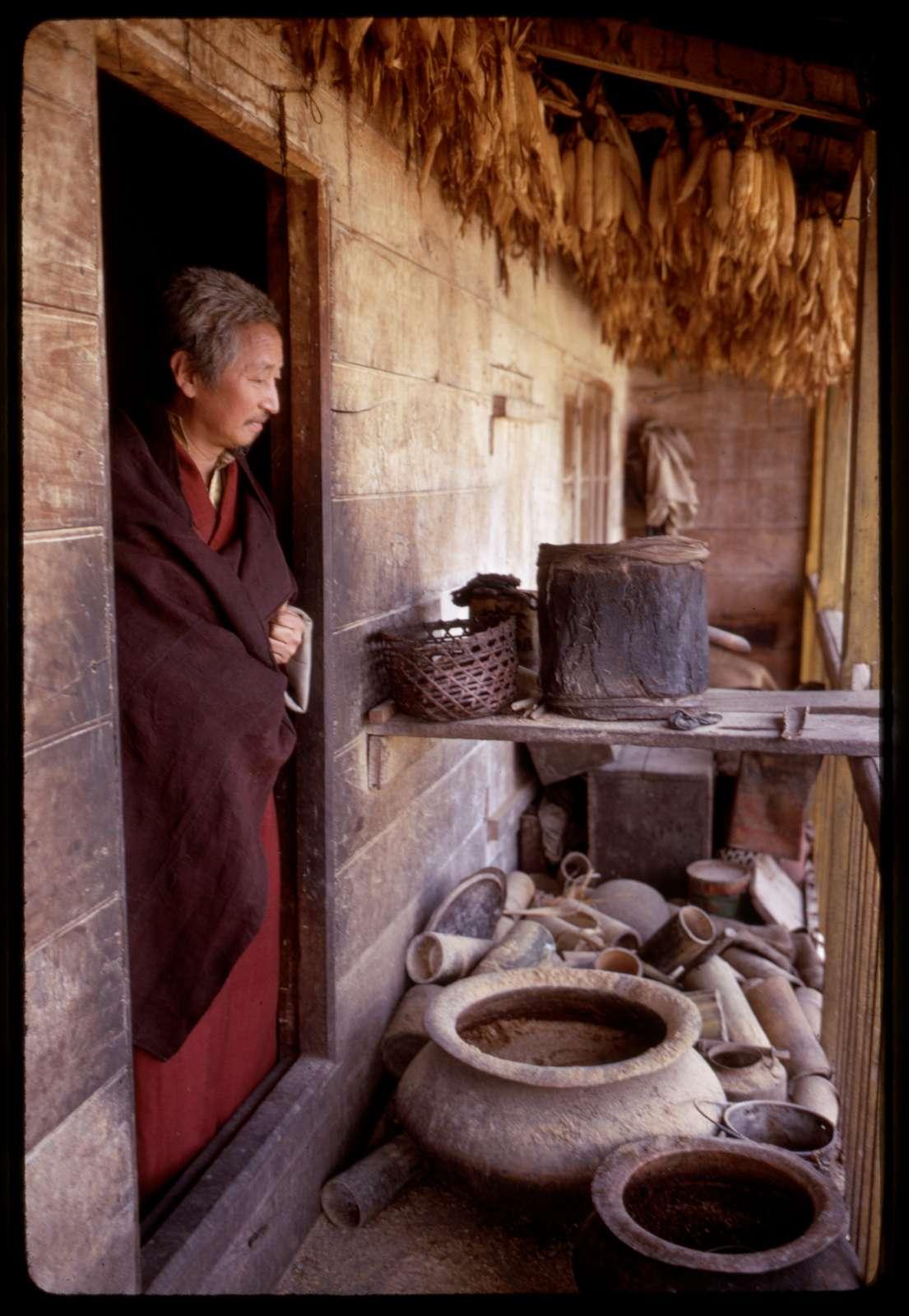 [Shinglay Lama looking out of farmhouse near Singhik, Sikkim]
