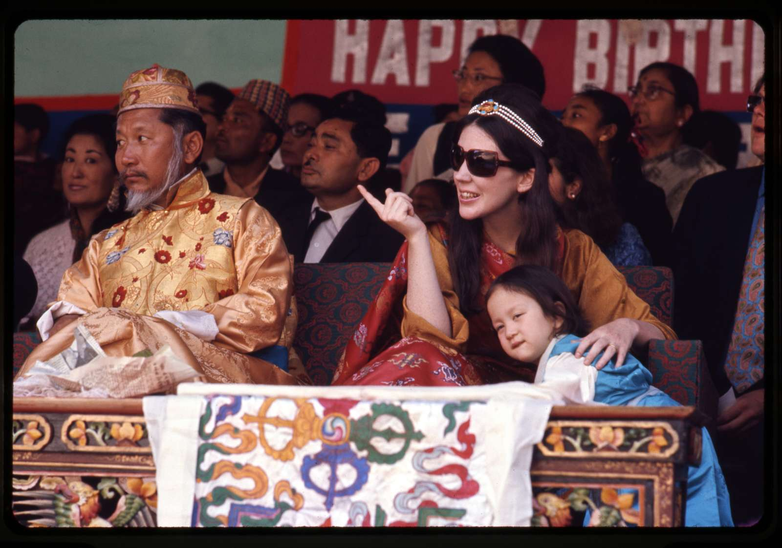 [King and Queen of Sikkim and their daughter Hope Leezum watch birthday celebrations, Gangtok, Sikkim]