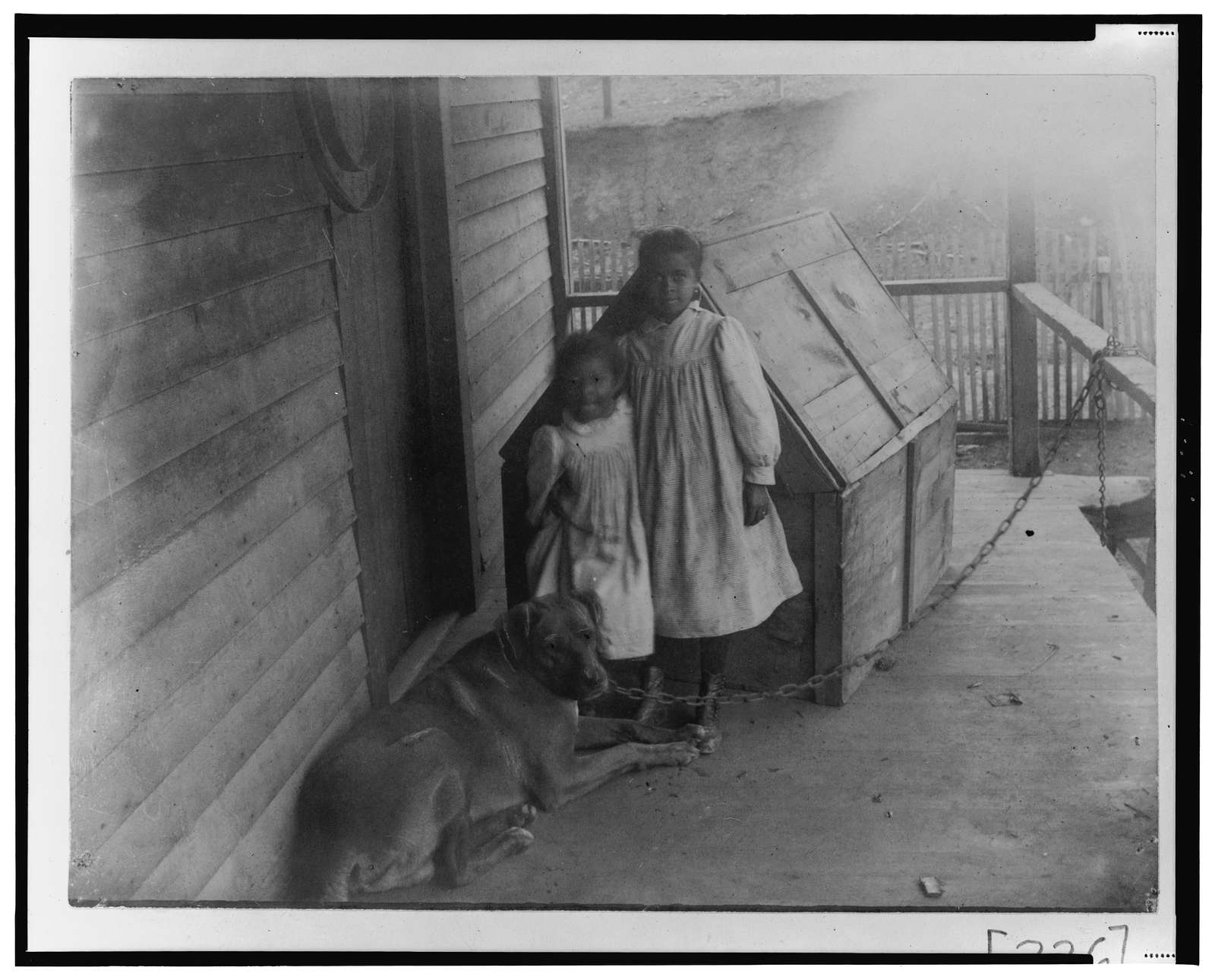 [Two African American children with a dog in Georgia]