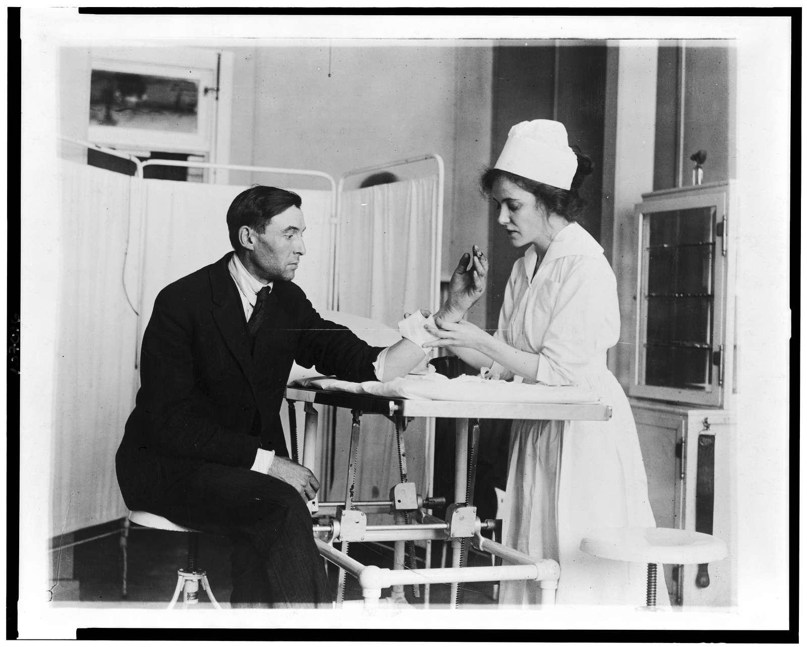 [Public Health Service nurse treating patient]