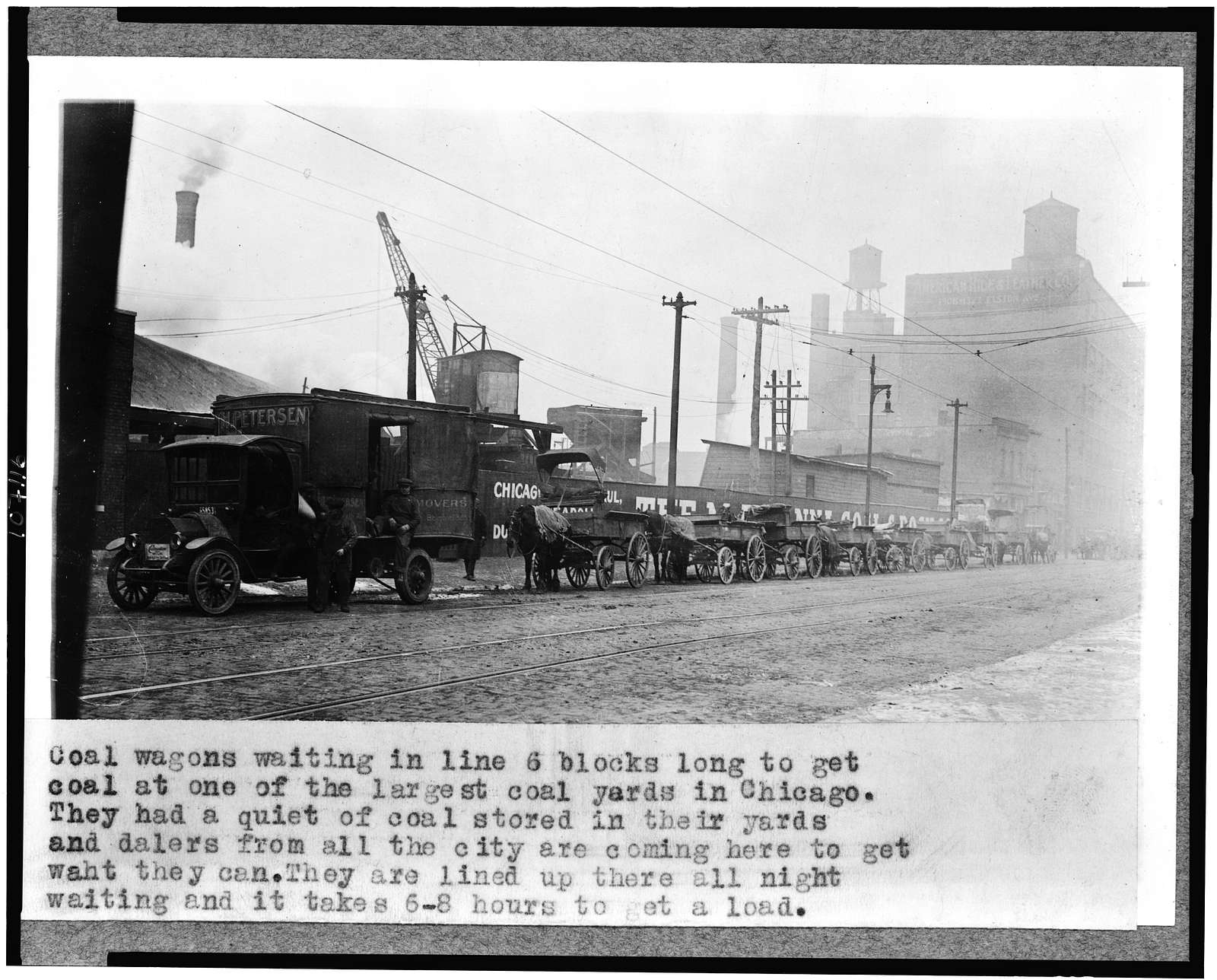 Coal wagons waiting in line 6 blocks long to get coal at one of the largest coal yards in Chicago ...