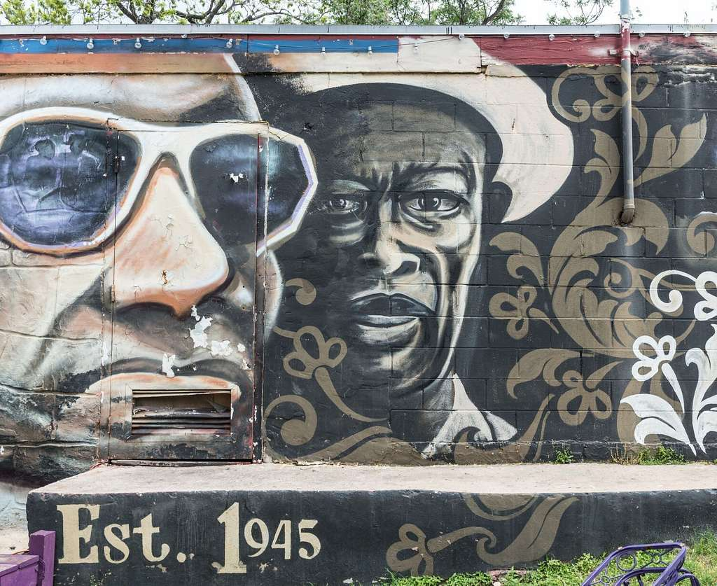 """Mural on the wall of the Victory Grill, a longtime """"juke joint"""" on 11th Street in East Austin, a neighborhood of Austin, Texas"""