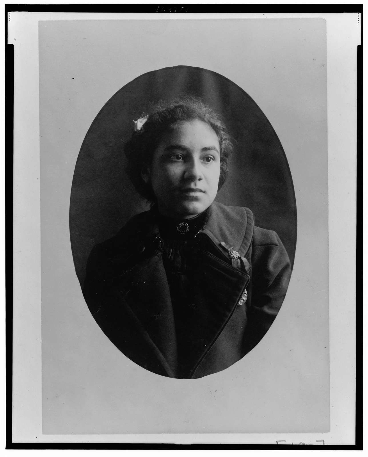[African American woman, head-and-shoulders portrait, facing front, wearing coat]