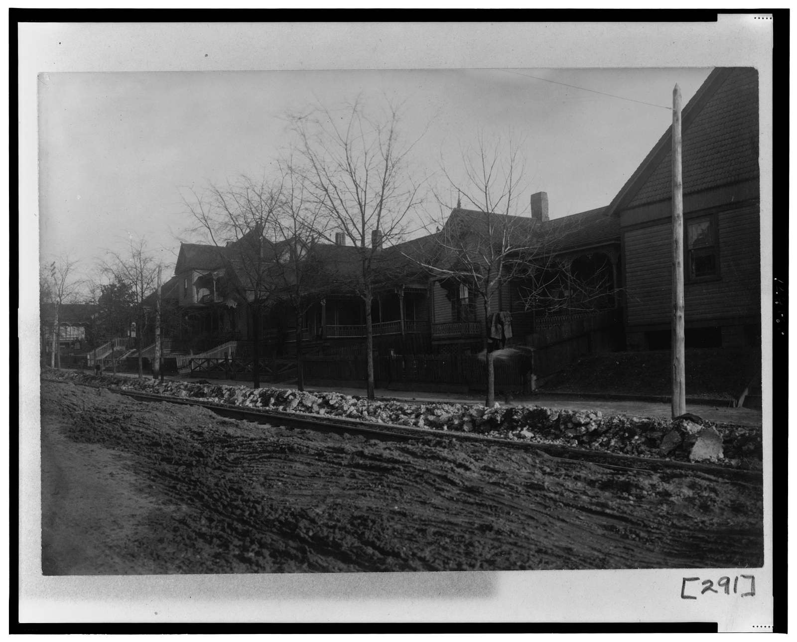 [Exterior view of houses along unpaved street in Georgia]