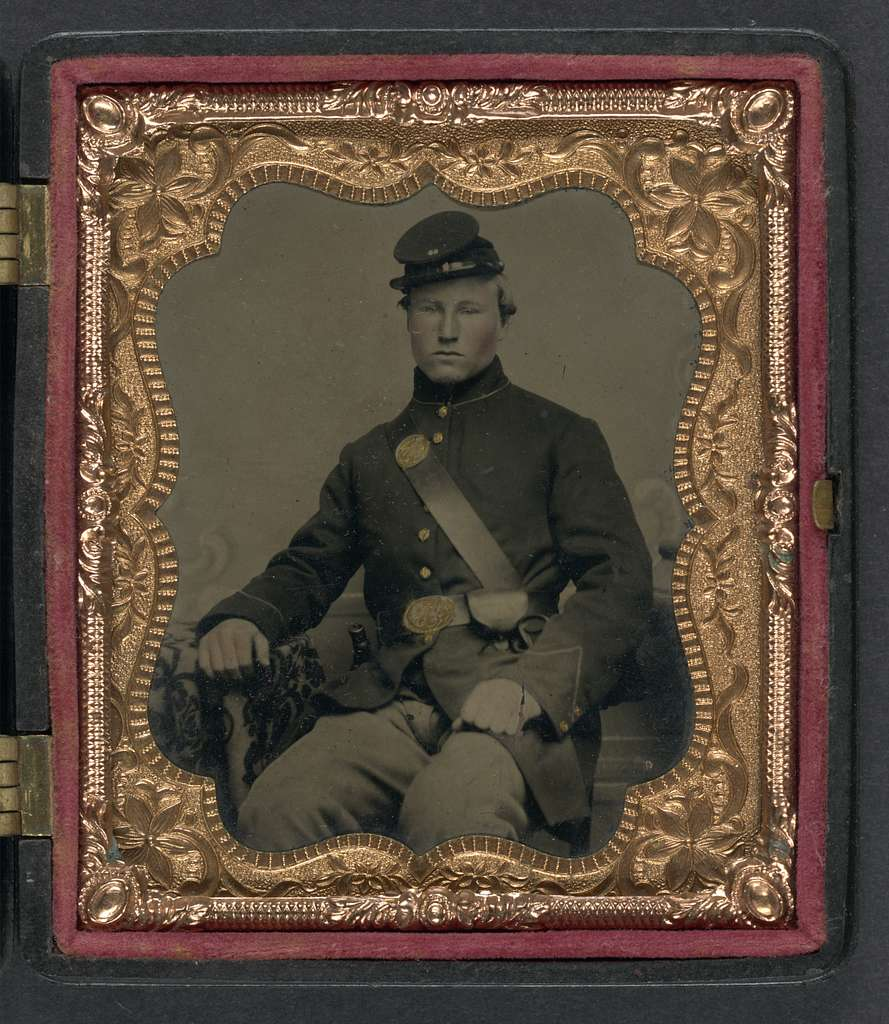 [Unidentified soldier in Union uniform and 28th Regiment forage cap with cap box]