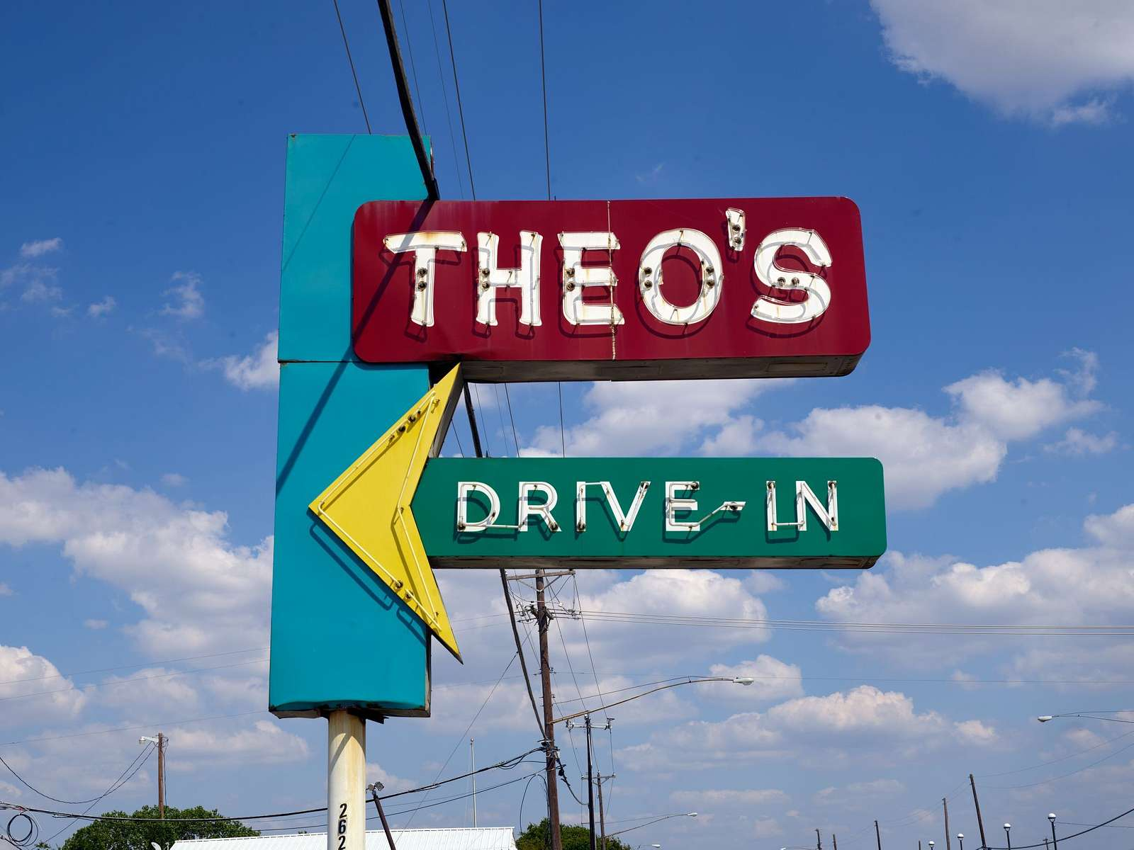 Neon sign for Theo's drive-in restaurant in Grand Prairie, Texas, along Texas Route 180, once the main road between Fort Worth and Dallas. The restaurant was founded by Greek immigrant Theo Chokas in 1956