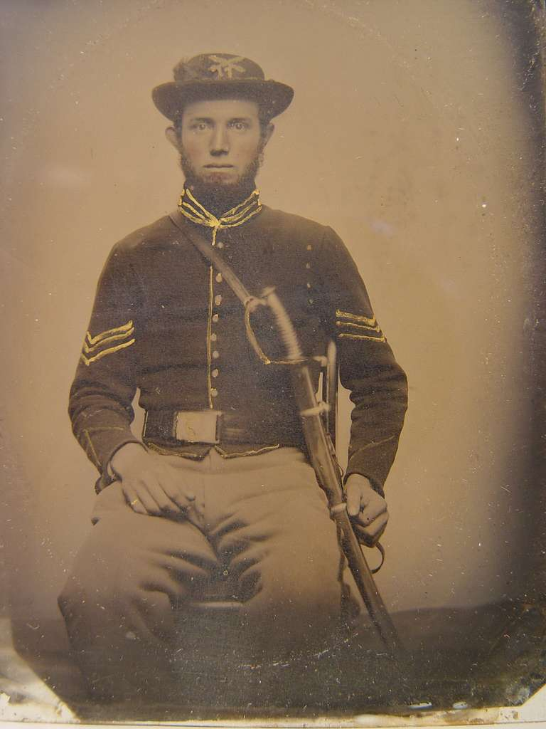 [Unidentified soldier in Union corporal's uniform and 17th Pennsylvania Cavalry Regiment slouch cap with U.S. Model 1860 cavalry saber]