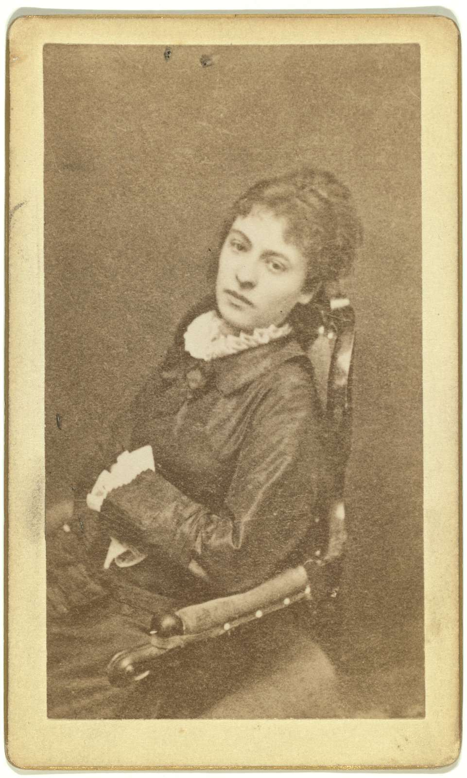 [Three-quarter length portrait of woman, seated in chair, facing left]