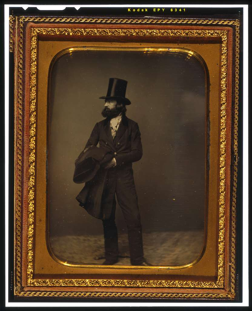 [William Sidney Mount, full length portrait, facing left, wearing top hat and holding a coat]