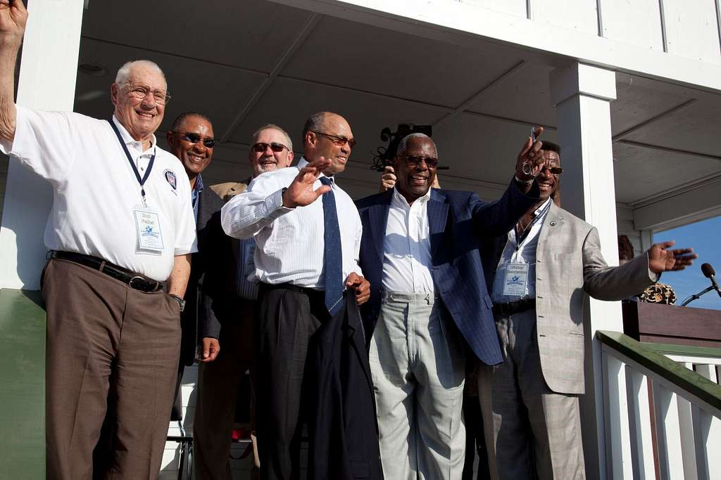 Bob Feller, Ozzie Smith, Bruce Sutter, Reggie Jackson, Hank Aaron and Rickey Henderson wave to the crowd on the porch of Hank Aaron boyhood home at the Dedication ceremony at the Hank Aaron Stadium, Mobile, Alabama