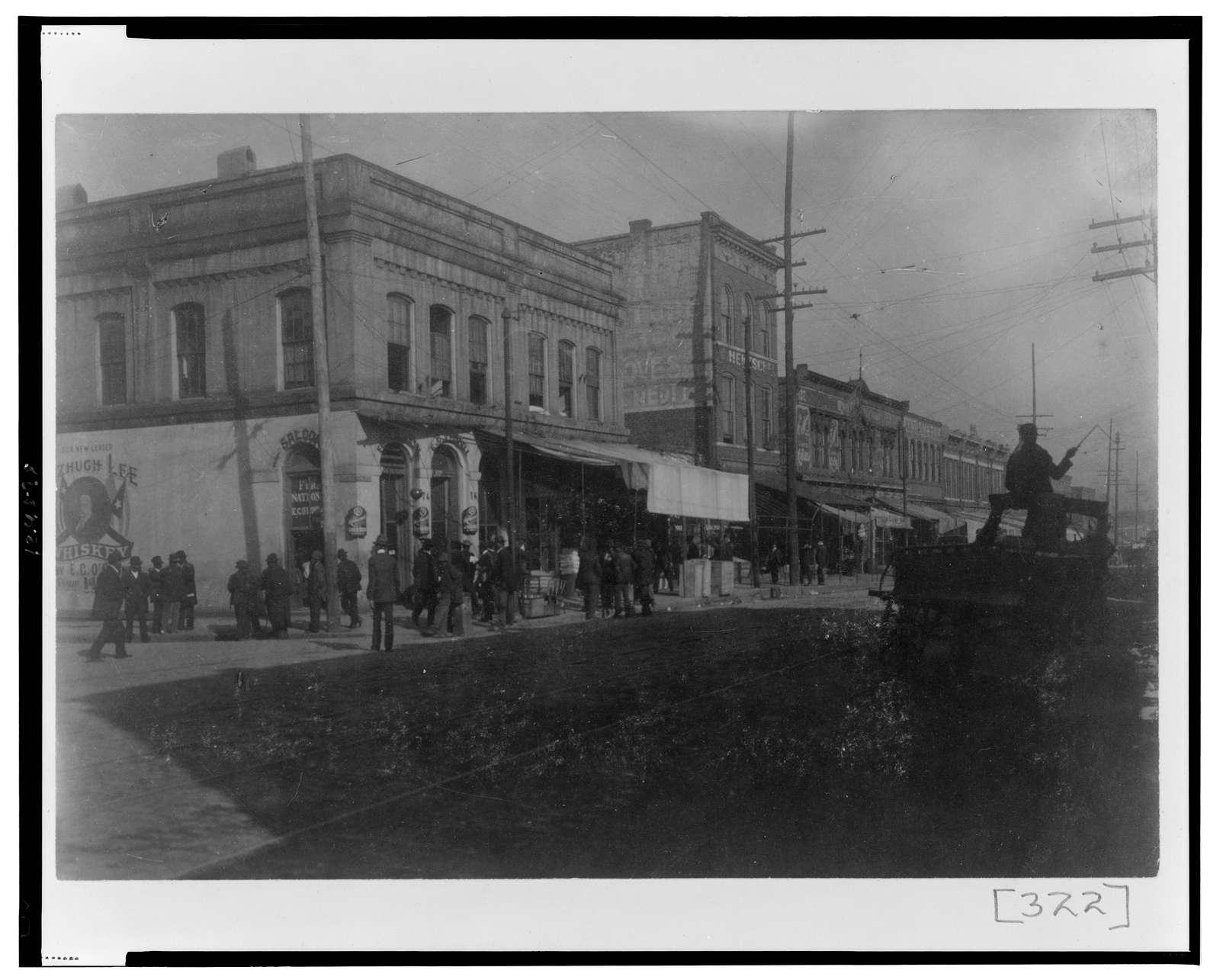 [Pedestrians on sidewalk along city street in Georgia]